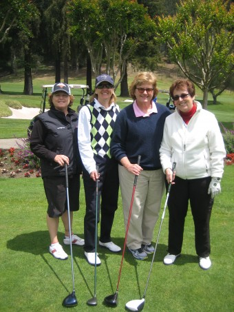 Hole sponsor and Executive Director, Corinne Mohrmann, having a ball with friends.