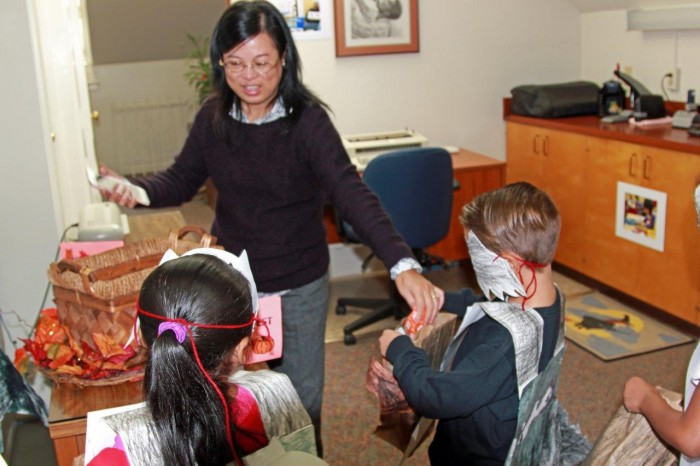 Children receive treats at the first Day Home Harvest Festival